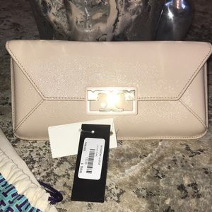 Tort Burch Clutch with gold embellishment